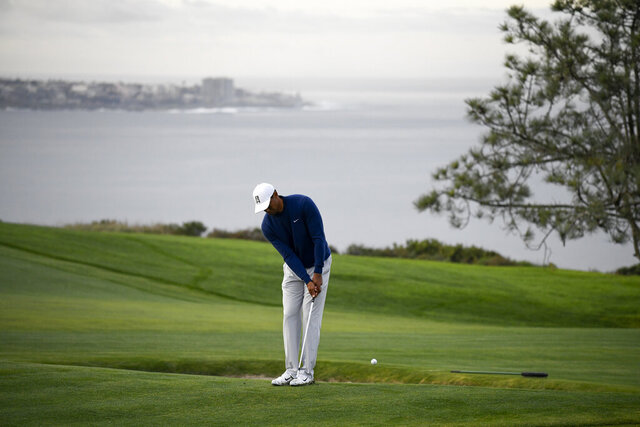 Tiger Woods hits his second shot on the fourth hole during the pro-am round of the Farmer's Insurance golf tournament on the South Course at Torrey Pines Golf Course on Wednesday, Jan. 22, 2020, in San Diego. (AP Photo/Denis Poroy)