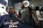 Barber Dwayne Speed gives a haircut to Artis White at World Class Faders (Barbershop) in Sacramento, Calif., Wednesday, July 28, 2021. Speed is a registered Democrat who says he is unsure how he'll vote in the Sept. 14 recall election against Democratic Gov. Gavin Newsom. (AP Photo/Rich Pedroncelli))