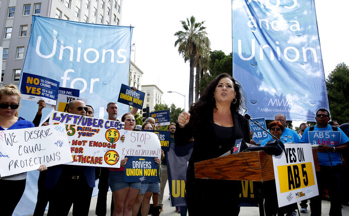 FILE -- In this Aug. 28, 2019, file photo, Assemblywoman Lorena Gonzalez, D-San Diego, speaks at rally calling for passage of her measure to limit when companies can label workers as independent contractors at the Capitol in Sacramento, Calif. Gov Gavin Newsom signed the bill, AB5, aimed at giving wage and benefit protections to ride share drivers and workers in other industries on Wednesday, Sept. 18, 2019. (AP Photo/Rich Pedroncelli, File)