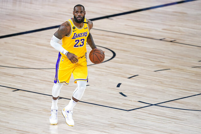 Los Angeles Lakers' LeBron James plays in the second half of an NBA basketball first round playoff game against the Portland Trail Blazers Saturday, Aug. 29, 2020, in Lake Buena Vista, Fla. The Lakers won 131-122 to win the series 4-1. (AP Photo/Ashley Landis)