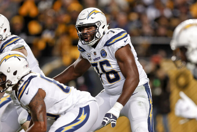 FILE - In this Dec. 2, 2018, file photo, Los Angeles Chargers offensive tackle Russell Okung (76) plays against the Pittsburgh Steelers in an NFL football game in Pittsburgh. Okung took part in his first practice since June 1, 2019, when he suffered a pulmonary embolism during an offseason workout at the team facility. He is being treated for blood clots and has been on the non-football injury list. (AP Photo/Don Wright, File)