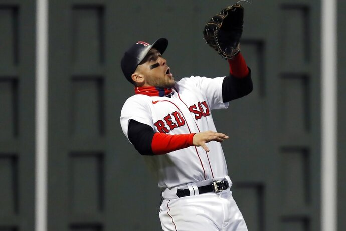 Boston Red Sox's Michael Chavis misses an RBI double by Baltimore Orioles' Rio Ruiz during the sixth inning of a baseball game Tuesday, Sept. 22, 2020, in Boston. (AP Photo/Michael Dwyer)