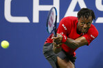 Gael Monfils, of France, returns a shot to Denis Shapovalov, of Canada, during the third round of the U.S. Open tennis tournament Saturday, Aug. 31, 2019, in New York. (AP Photo/Jason DeCrow)