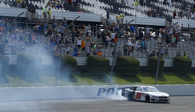 Cole Custer does a burnout as he celebrates after winning the NASCAR Xfinity Series auto race at Pocono Raceway, Saturday, June 1, 2019, in Long Pond, Pa. (AP Photo/Matt Slocum)