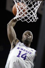 Kansas State forward Makol Mawien dunks during the second half of the team's NCAA college basketball game against Monmouth in Manhattan, Kan., Wednesday, Nov. 13, 2019. (AP Photo/Orlin Wagner)