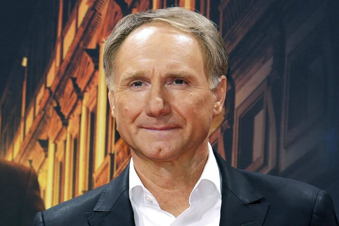 FILE - In this Oct. 10, 2016 file photo, author Dan Brown arrives for the premiere of the movie