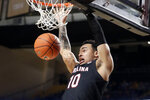 South Carolina forward Justin Minaya dunks the ball against Vanderbilt in the second half of an NCAA college basketball game Saturday, March 7, 2020, in Nashville, Tenn. Vanderbilt won 83-74. (AP Photo/Mark Humphrey)