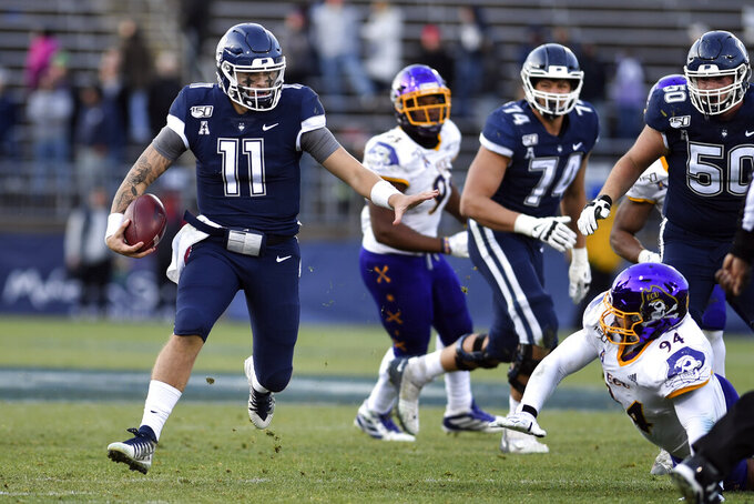 FILE - In this Nov. 23, 2019, file photo, Connecticut quarterback Jack Zergiotis (11) heads downfield during an NCAA college football game against East Carolina in East Hartford, Conn. UConn returns to the football field Saturday, Aug. 28, 2021, for the first time in 637 days when it travels to Fresno State. (AP Photo/Stephen Dunn, File)