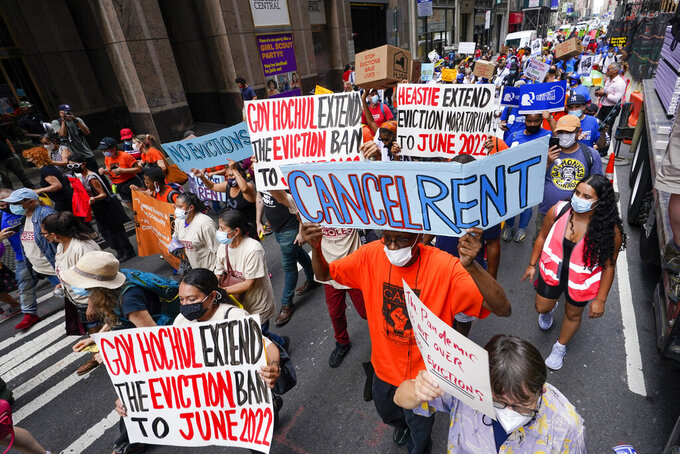 Activist march across town towards New York Gov. Kathy Hochul office, Tuesday, Aug. 31, 2021, in New York, during a demonstration to call on Hochul, Speaker Carl Heastie, and Senate Majority Leader Andrea Stewart-Cousin to extend pandemic era eviction protections in wake of Supreme Court decision lifting the moratorium. (AP Photo/Mary Altaffer)
