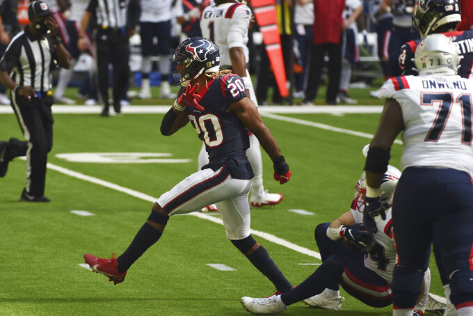Houston Texans strong safety Justin Reid (20) celebrates after making a play against the New England Patriots during the first half of an NFL football game, Sunday, Nov. 22, 2020, in Houston. (AP Photo/Eric Christian Smith)