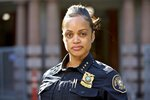 In this Aug. 5, 2019, photo, Portland Police Chief Danielle Outlaw poses for a photo in Portland, Ore.