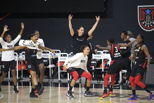 Las Vegas Aces players celebrate after getting the win over the Connecticut Sun in Game 5 of a WNBA basketball semifinal round playoff series, Tuesday, Sept. 29, 2020, in Bradenton, Fla. (AP Photo/Phelan M. Ebenhack)