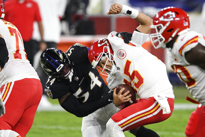 Baltimore Ravens linebacker Tyus Bowser (54) tries but cannot sack Kansas City Chiefs quarterback Patrick Mahomes (15) during the first half of an NFL football game Monday, Sept. 28, 2020, in Baltimore. (AP Photo/Nick Wass)