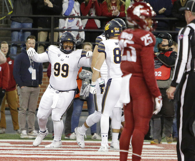 California fullback Malik McMorris (99) celebrates his touchdown catch with teammates during the first half of an NCAA college football game against Washington State in Pullman, Wash., Saturday, Nov. 3, 2018. (AP Photo/Young Kwak)