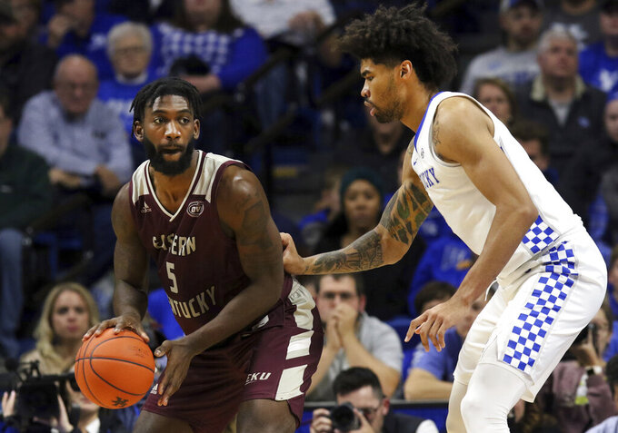 Eastern Kentucky's Darius Hicks (5) looks for an opening as Kentucky's Nick Richards, right, defends during the second half of an NCAA college basketball game in Lexington, Ky., Friday, Nov. 8, 2019. Kentucky won 91-49. (AP Photo/James Crisp)