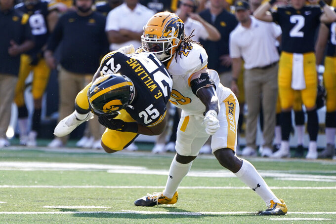Iowa running back Gavin Williams (25) catches a pass ahead of Kent State safety C.J. Holmes (29) during the first half of an NCAA college football game, Saturday, Sept. 18, 2021, in Iowa City, Iowa. (AP Photo/Charlie Neibergall)
