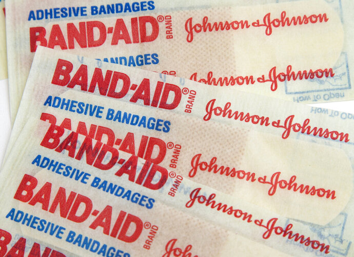 FILE - This Sept. 13, 2016, file photo, shows Johnson & Johnson Band-Aid brand bandages in Surfside, Fla.  Higher prescription drug sales and lower costs for litigation drove up Johnson & Johnson's fourth-quarter profit by 32%. The world's biggest maker of health care products on Wednesday, July 15, 2020, reported net income rose nearly $1 billion, to $4.01 billion, or $1.50 per share. (AP Photo/Wilfredo Lee, File)