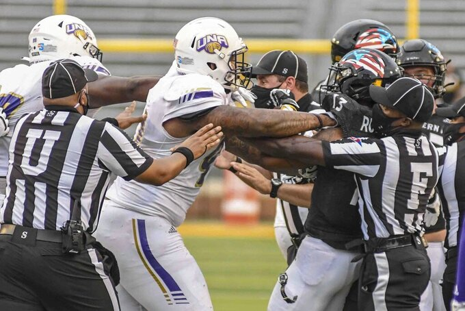 Two players, Mike Boykin, UNA defensive end, and Antoine Robinson, Southern Miss wide receiver, break out into a fight during the Southern Miss and University of North Alabama NCAA football game in Hattiesburg, Miss., Saturday, Nov. 7, 2020. (Cam Bonelli/Hattiesburg American via AP)