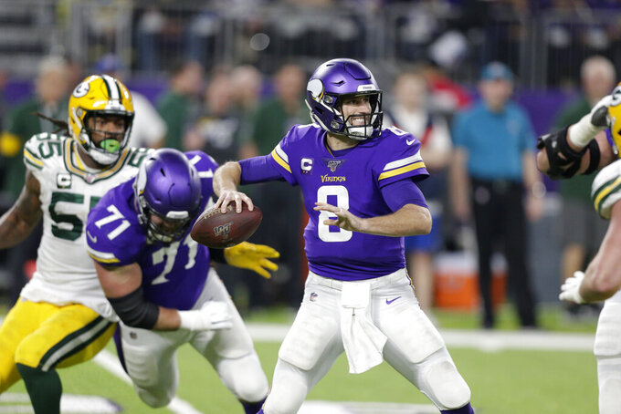 "FILE - In this Monday, Dec. 23, 2019 file photo, Minnesota Vikings quarterback Kirk Cousins throws a pass during the second half of an NFL football game against the Green Bay Packers in Minneapolis. Minnesota Vikings quarterback Kirk Cousins says he's unconcerned about catching the coronavirus. He says his worry on a scale of one to 10 is ""about a 0.000001."" Cousins made his comments on a wide-ranging interview for an NFL-themed podcast that was released on Wednesday, Sept. 2, 2020. (AP Photo/Andy Clayton-King, File)"