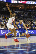 Memphis' Isaiah Maurice drives the ball past Houston's Brinson Gresham in the first half of an NCAA college basketball game at the American Athletic Conference tournament Saturday, March 16, 2019, in Memphis, Tenn. (AP Photo/Troy Glasgow)
