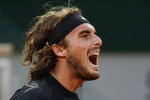 Greece's Stefanos Tsitsipas screams in the quarterfinal match of the French Open tennis tournament against Russia's Andrey Rublev at the Roland Garros stadium in Paris, France, Wednesday, Oct. 7, 2020. (AP Photo/Alessandra Tarantino)