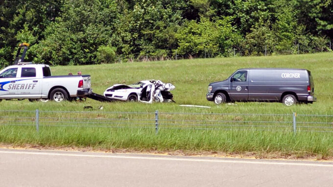 This image taken from video and provided by KTBS-TV shows a Caddo Parish Sheriff's Office patrol car that was hit from behind by a Kia, killing the deputy, who was diverting traffic around an earlier wreck. (Randy Bain/KTBS-TV via AP)