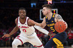 St. John's Mustapha Heron (0) defends against West Virginia's Jordan McCabe (5) in the first half of an NCAA college basketball game Saturday, Dec. 7, 2019 in New York. St. John's won 70-68. (AP Photo/Mark Lennihan)