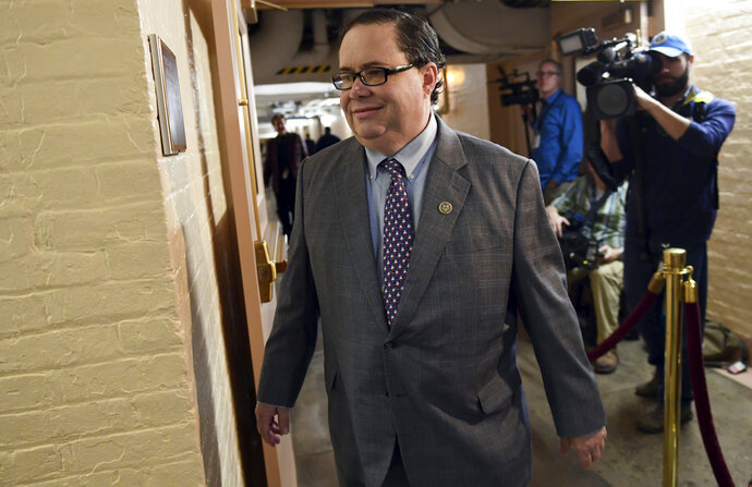 FILE - In this Dec. 19, 2017, file photo, Rep. Blake Farenthold, R-Texas, arrives for a meeting of House Republicans on Capitol Hill in Washington. The Treasury Department has paid out almost $300,000 in taxpayer funds to settle claims brought against Congressional offices that include sexual harassment and sex discrimination since 2003. One of those settlements, for $84,000, stemmed from a 2014 lawsuit brought against Farenthold by his former communications director. Farenthold denied the allegations. But after the settlement was revealed late last year Farenthold pledged to pay the money back. (AP Photo/Susan Walsh, File)