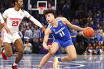 Memphis guard Lester Quinones (11) looks to shoot as Houston Cedrick Alley Jr. (23) moves in, in the second half of an NCAA college basketball game Saturday, Feb. 22, 2020, in Memphis, Tenn. (AP Photo/Karen Pulfer Focht)