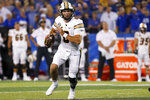 Missouri quarterback Connor Bazelak (8) looks for an open receiver during the second half of an NCAA college football game against Kentucky in Lexington, Ky., Saturday, Sept. 11, 2021. (AP Photo/Michael Clubb)