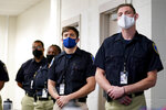 In this Sept. 9, 2020, photo Zachary Ruhling, center, a cadet in the Baltimore Police Academy, watches a video presentation during a class session focusing on procedural justice in Baltimore. (AP Photo/Julio Cortez)