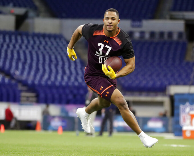 FILE - In this March 4, 2019, file photo, Mississippi State defensive back Johnathan Abram runs a drill at the NFL football scouting combine in Indianapolis Abram is a possible pick in the 2019 NFL Draft. (AP Photo/Michael Conroy, File)