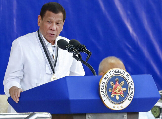 In this Feb. 25, 2020 photo provided by the Malacanang Presidential Photographers Division, Philippine President Rodrigo Duterte delivers his speech during the Presidential Security Group Change of Command ceremony at the PSG Compound in Malacañang Park, Manila, Philippines. Philippine President Rodrigo Duterte on Wednesday said Filipino forces can fight insurgents and Muslim extremists without American military help in a defense of his recent move to notify the United States of his government's intent to terminate a major security pact. (Robinson Ninal Jr./Malacanang Presidential Photographers Division via AP)