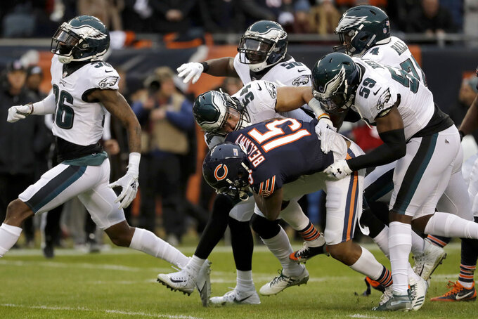 Chicago Bears wide receiver Josh Bellamy (15) is tackled by Philadelphia Eagles linebackers Kamu Grugier-Hill (54) and B.J. Bello (59) during the first half of an NFL wild-card playoff football game Sunday, Jan. 6, 2019, in Chicago. (AP Photo/Nam Y. Huh)