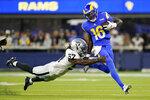 Los Angeles Rams quarterback Bryce Perkins, right, is tackled by Las Vegas Raiders linebacker Asmar Bilal (57) during the first half of a preseason NFL football game Saturday, Aug. 21, 2021, in Inglewood, Calif. (AP Photo/Ashley Landis)
