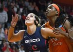 Washington Mystics' Elena Delle Donne, left, and Connecticut Sun's Jonquel Jones battle for position under the basket during the first half in Game 3 of basketball's WNBA Finals, Sunday, Oct. 6, 2019, in Uncasville, Conn. (AP Photo/Jessica Hill)