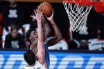 Memphis Grizzlies' Jaren Jackson Jr. shoots over San Antonio Spurs' Drew Eubanks during the second half of an NBA basketball game Sunday, Aug. 2, 2020, in Lake Buena Vista, Fla. (AP Photo/Ashley Landis, Pool)