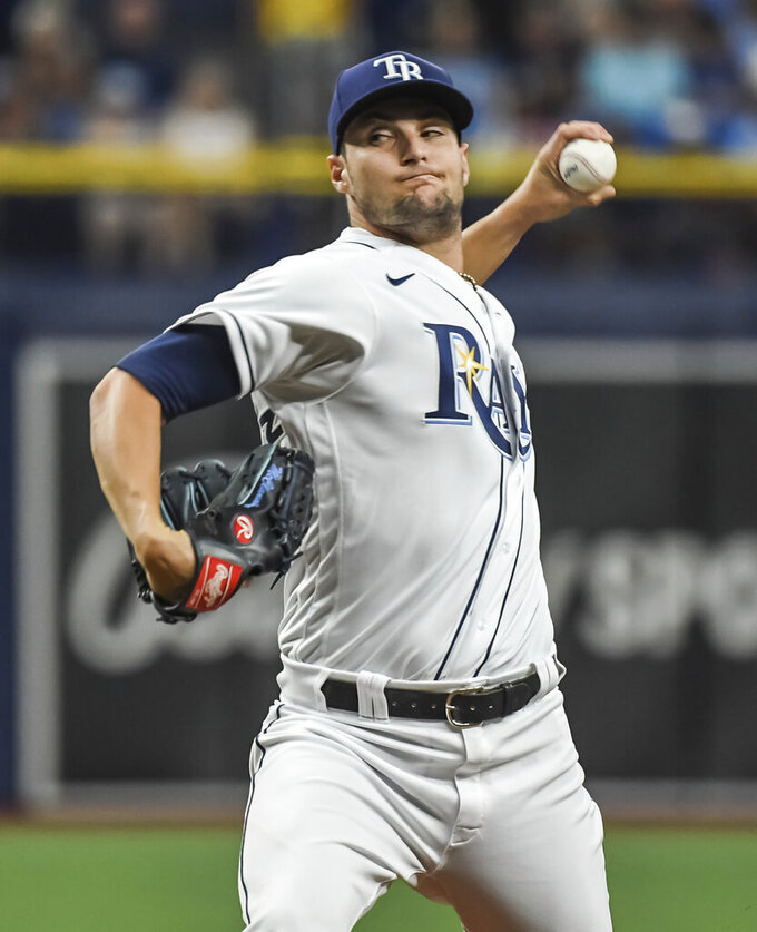 Tampa Bay Rays starter Shane McClanahan throws to a New York Yankees batter during the first inning of a baseball game Tuesday, July 27, 2021, in St. Petersburg, Fla. (AP Photo/Steve Nesius)