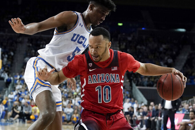FILE - In this Feb. 29, 2020, file photo, Arizona guard Jemarl Baker Jr. drives to the basket past UCLA guard Chris Smith during the first half of an NCAA college basketball game in Los Angeles. Baker Jr., Ira Lee and Christian Koloko are the only returning players to Arizona who had significant playing time last season. (AP Photo/Chris Carlson, File)