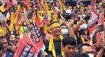 In this image taken from video by Taiwan's EBC, supporters of the ousting of the Kaohsiung mayor in a recall vote celebrate the results in Kaohsiung, Taiwan on Saturday, June 6, 2020. Residents of the Taiwanese port city of Kaohsiung voted Saturday to oust their mayor, whose failed bid for the presidency on behalf of the China-friendly Nationalist Party earlier this year brought widespread disapproval among residents. (EBC via AP Video)