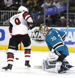 San Jose Sharks goaltender Aaron Dell (30) blocks a shot by Arizona Coyotes center Clayton Keller during the second period of an NHL hockey game Saturday, Jan. 13, 2018, in San Jose, Calif. (AP Photo/Tony Avelar)