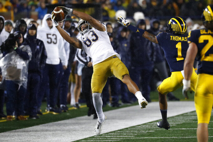 Notre Dame wide receiver Chase Claypool (83) catches a pass against Michigan in the first half of an NCAA college football game in Ann Arbor, Mich., Saturday, Oct. 26, 2019. (AP Photo/Paul Sancya)