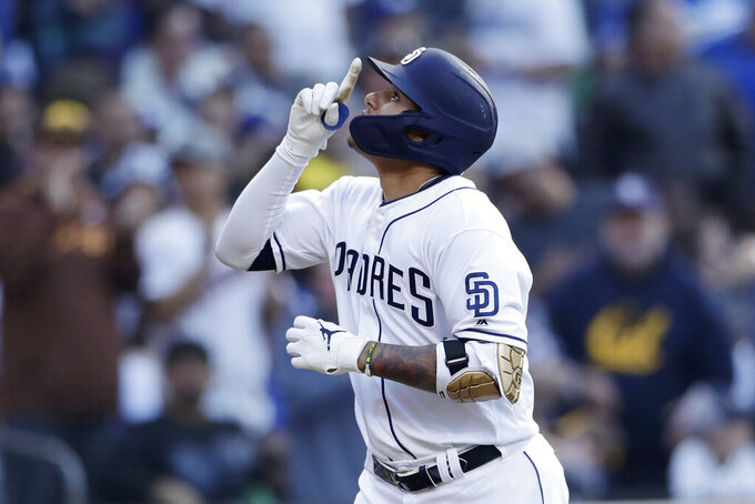 San Diego Padres' Manny Machado runs the bases after hitting a home run during the third inning of the team's baseball game against the Los Angeles Dodgers, Saturday, May 4, 2019, in San Diego. (AP Photo/Gregory Bull)