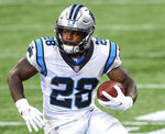 FILE - Then-Carolina Panthers running back Mike Davis (28) runs against the Atlanta Falcons during the first half of an NFL football game in Atlanta, in this Sunday, Oct. 11, 2020, file photo. With little money to spend in free agency, the Atlanta Falcons are looking to make a splash with overachieving players who don't take a big chunk out of the budget. Safety Erik Harris epitomizes a low-cost, low-risk class of free agents that grew Thursday, March 25, 2021, when the team finalized deals with well-traveled running back Mike Davis, linebacker Barkevious Mingo, and cornerback Fabian Moreau.(AP Photo/Danny Karnik, File)