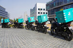 A delivery driver for the app Deliveroo prepares to make a delivery, in Dubai, United Arab Emirates, Thursday, Sept. 9, 2021. Advocates and workers say that casualties among food delivery riders are mounting in the city of Dubai, as the pandemic accelerates a boom in customer demand. The trend has transformed Dubai's streets and drawn thousands of desperate riders, predominantly Pakistanis, into the high-risk, lightly regulated and sometimes-fatal work. (AP Photo/Jon Gambrell)