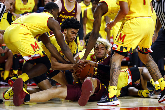 Cowan scores 21 as No. 24 Maryland beats Minnesota 69-60