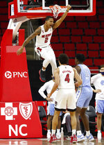 North Carolina State's Shakeel Moore (2) celebrates after a dunk against North Carolina during the first half of an NCAA college basketball game in Raleigh, N.C., Tuesday, Dec. 22, 2020 (Ethan Hyman/The News & Observer via AP)