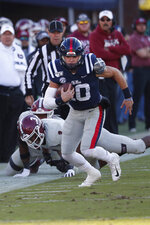 Mississippi quarterback John Rhys Plumlee (10) runs past New Mexico State linebacker Devin Richardson (3) during the first half of an NCAA college football game in Oxford, Miss., Saturday, Nov. 9, 2019. (AP Photo/Rogelio V. Solis)