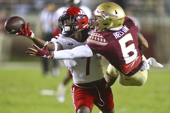 Jacksonville State cornerback Yul Gowdy (7) attempts to intercept a pass to Florida State wide receiver Keyshawn Helton (6) during the fourth quarter of an NCAA college football game Saturday, Sept. 11, 2021, in Tallahassee, Fla. The pass was incomplete. Jacksonville State won 20-17. (AP Photo/Phil Sears)