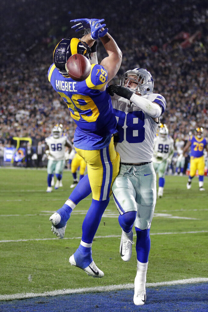 Dallas Cowboys strong safety Jeff Heath, right, breaks up a pass intended for Los Angeles Rams tight end Tyler Higbee during the first half in an NFL divisional football playoff game Saturday, Jan. 12, 2019, in Los Angeles. (AP Photo/Jae C. Hong)